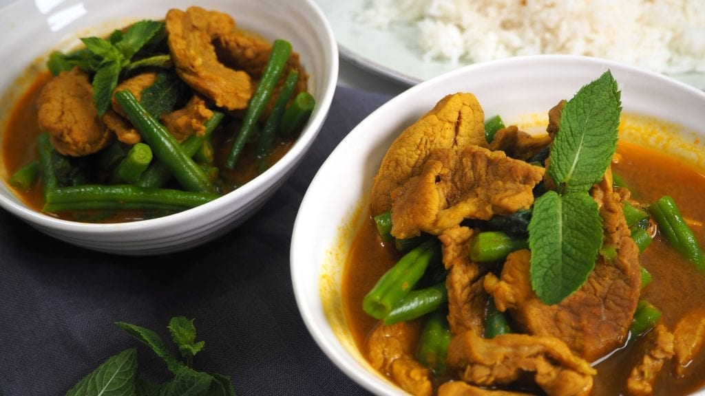 pork Thai Jungle Curry with Green beans and fresh mint in a white bowl, authentic, traditional, Thai jungle paste, Mae Jum
